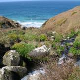 Streams tumbled down over the boulders to the sea
