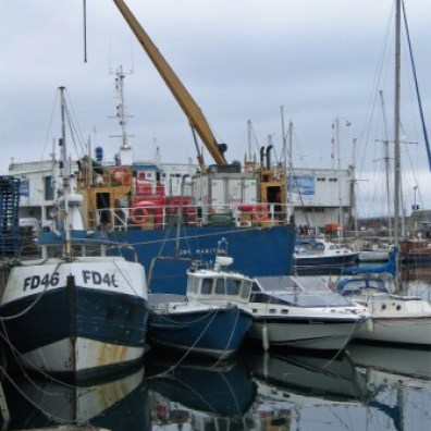 Cranes and fishing boats in Penzance harbour