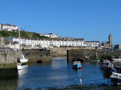 The orderly terrace of house above porthleven harbour