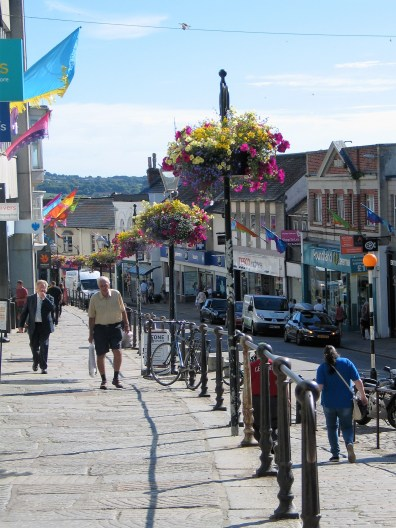 The raised granite terrace of market jew street in Penzance full of flowers