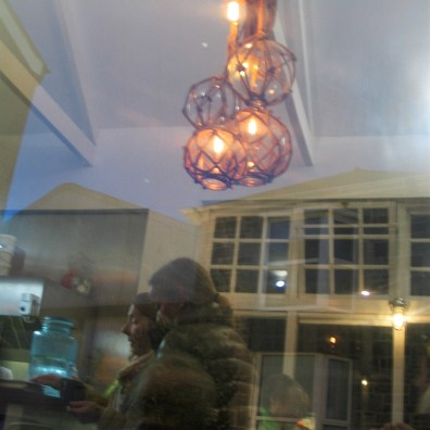 I sat and admired the restaurant refleced in the window in front of me