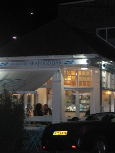 We ate supper at Mackerel Sky Seafood bar in Newlyn and I took a snap as we left of teh brightly lit restaurant