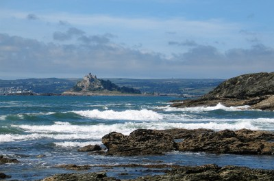 Waves tumbling in across Mounts bay in cornwall for a classic cornish coastline