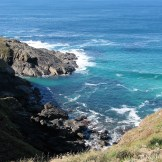 The sea swirling below the cornish cliffs near to Land's End