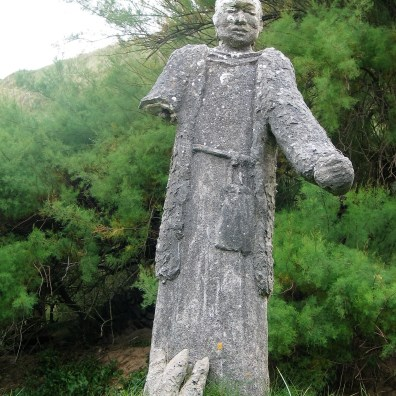 Worn statue of a monk