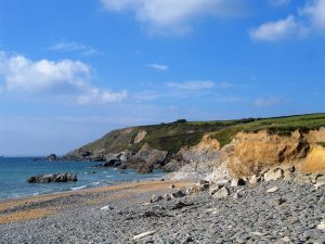 cornish cove below blue skies