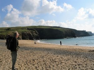 An expansive nearly empty sandy cove at Gunwalloe