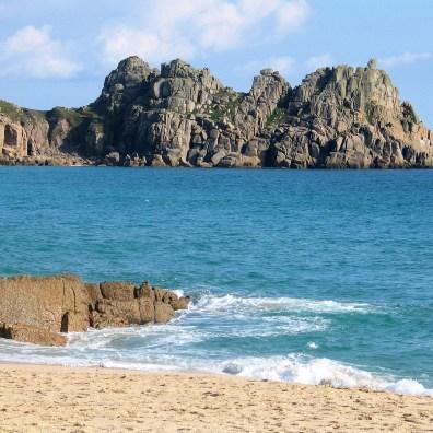 Th Logan rock headland rises from the sea