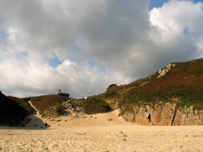 Clouds forming behind the dunes at Porthcurno