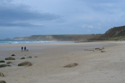 distant figures at low tide on Sennen beach