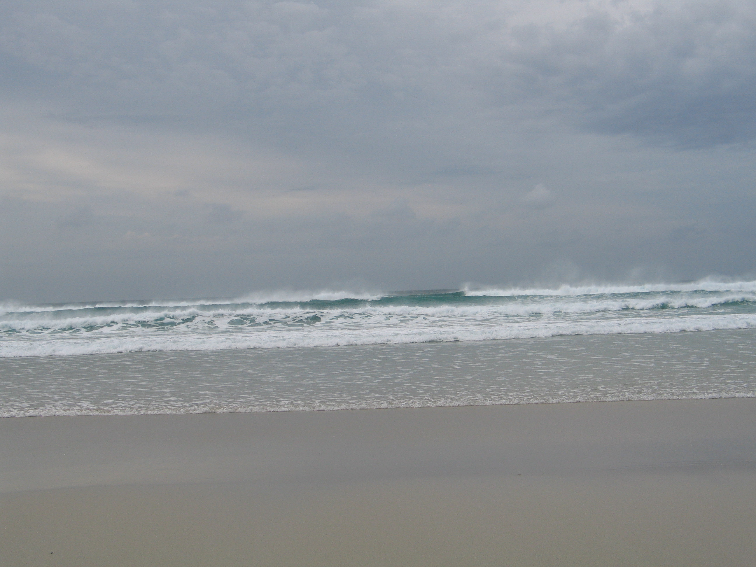 waves trailing vapour rolled towards the beach