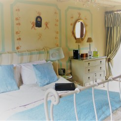 Stenciled faux paneling behind the sleigh bed