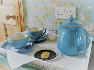 Teapot and cups in freshly decorated bedroom