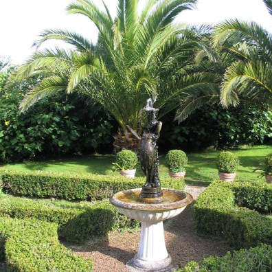 Fountain framed by box parterre