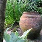 terracotta pot on cobble patio
