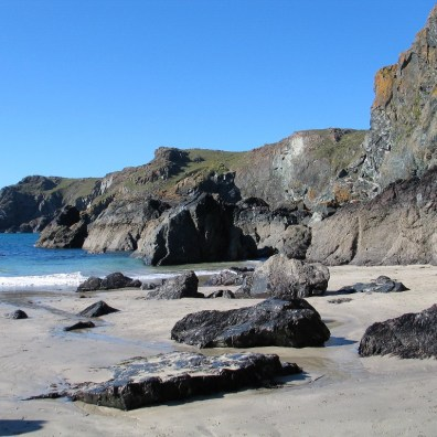 Exploring the sandy beach flanked by cliffs