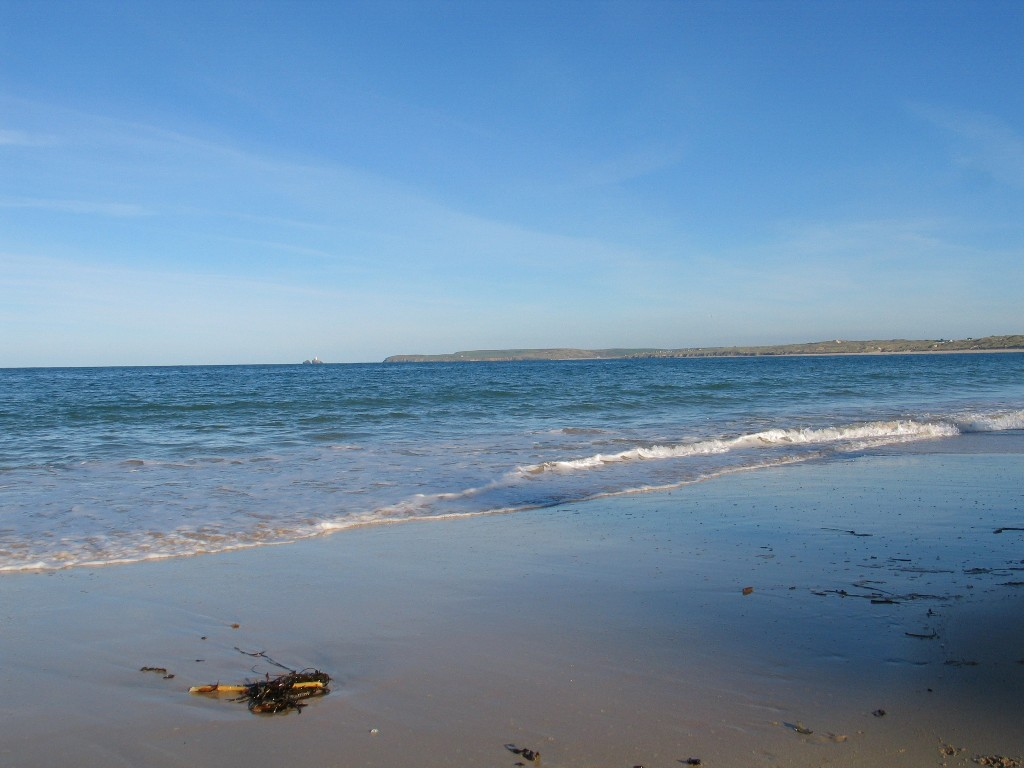 A gentle wave lapping the sands at Carbis Bay