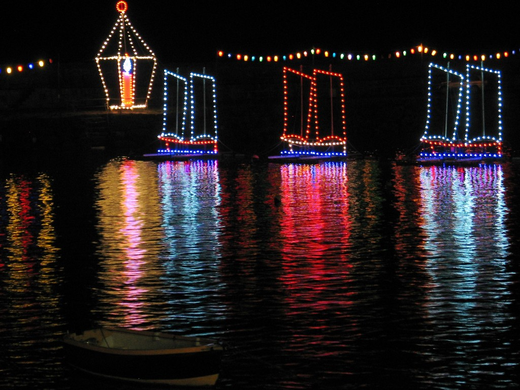 "A lone boat and christmas lights depicting ""three ships"""