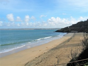 figure on the tide line - looking down on Porthminster Beach in winter