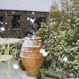 Big snow flakes falling on a Greek pot