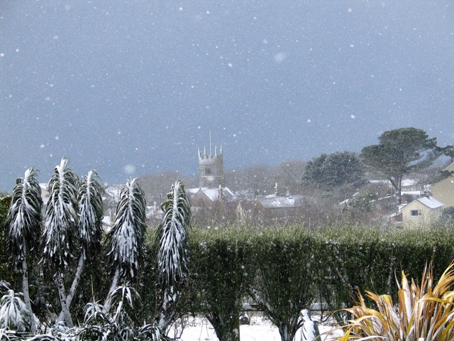 snow falling as the beast from the east arrives in conrwall - view to Perranuthnoe church