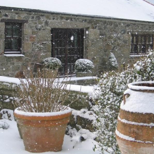 A garden transformed - greek pots in the snow