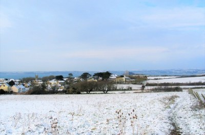 March madness sees the front field clothed in snow with white topped hills across Mounts Bay