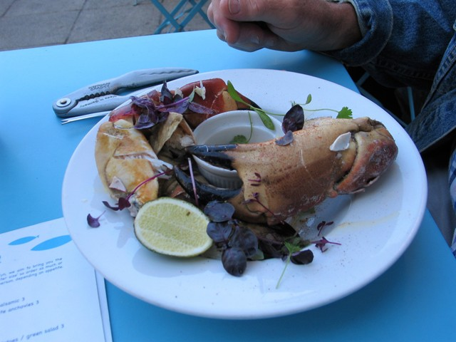 crab claws on the menu eating near a harbour Newlyn