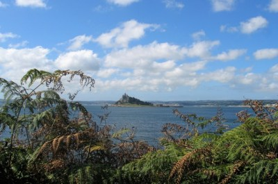 Autumn russet bracken framing ST Michael's Mount in a blue sea