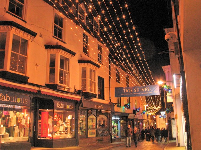 Christmas lights over cobbled street