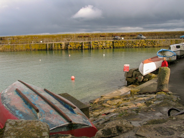 Empty harbour and upturned boat