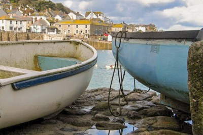 Mousehole Postcard of two dingeys on a harbour framed by cottages and sea