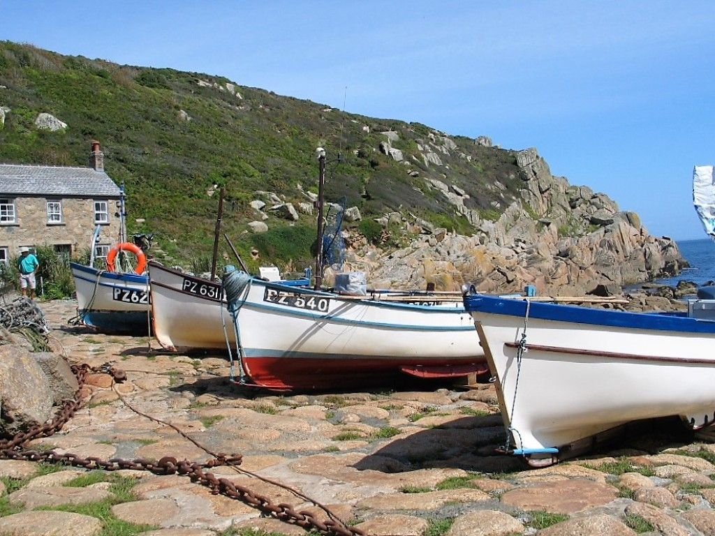 Fishing boats pulled up from teh sea at Penberth cove