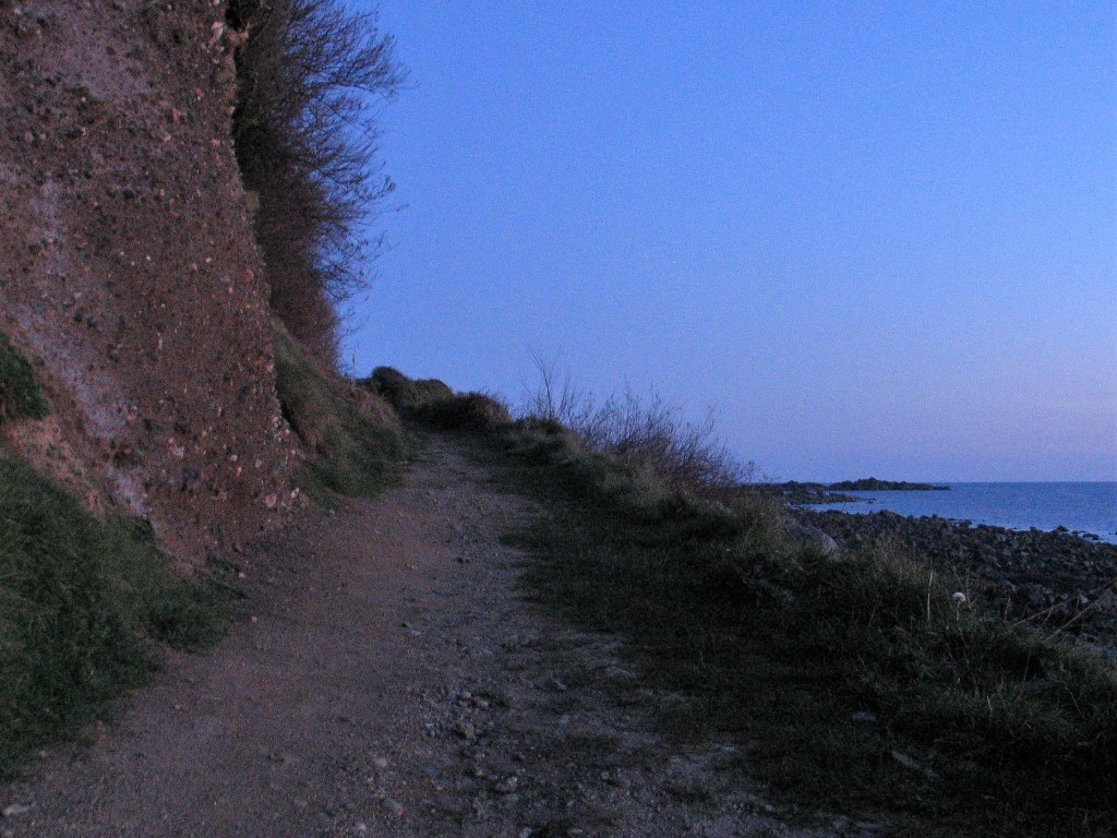 Walking home from a witner picnic up the beach slip way at dusk