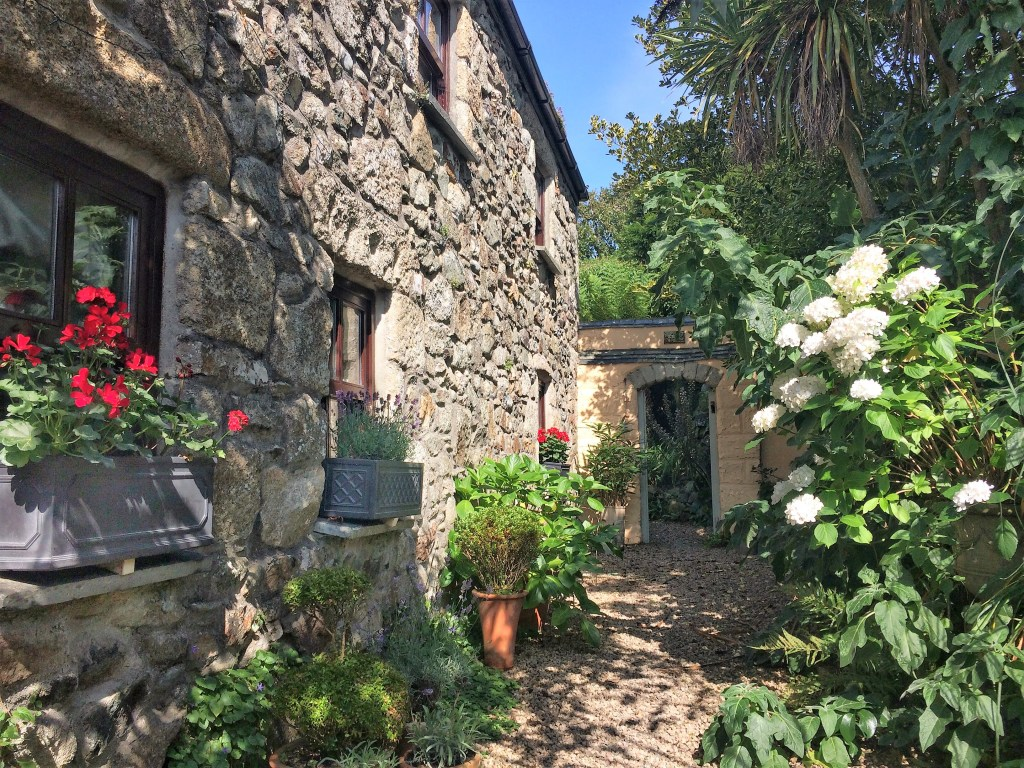 The french inspired rear courtyard to Ednovean Farm. The search for Gallic charm