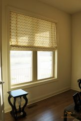 Lined flat roman shade with seams for a wide window at office