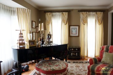 Interlined silk panels with classic swags and trim accent for formal room.