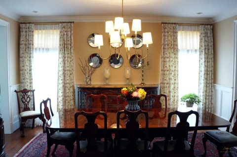 """Pinch pleated panels on 1/2"""" metal rod with full function for a traditional dining room."""