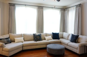 """Family room panels on a set of 1"""" metal rods with 90 degree angle."""