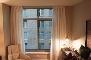 Inverted sheer panels for guest bedroom