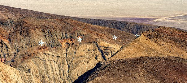 "F-18 jet exiting ""Star Wars Canon"" into Death Valley at Father C"