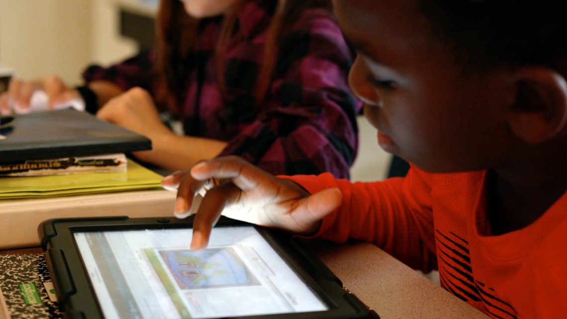 CREDIT Discovery Education Science Techbook Rock-Hill-Boy-iPad.jpg