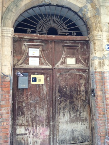 Ancient timber doors lead into a palazzo