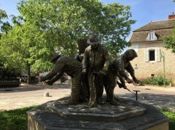 This sculpture shows people working the land manually as they have done for generations