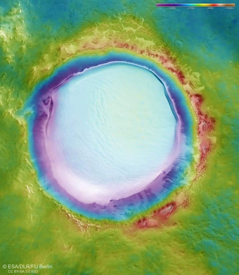 Color-coded image showing the topography where the lower parts of the surface are shown in blues and purples, while higher-altitude regions are shown in whites, browns and reds.