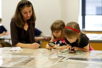 Girls examining documents