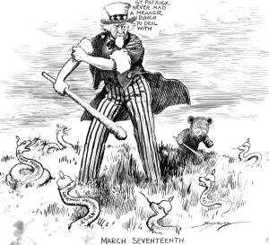 A determined Uncle Sam rolls up his sleeves and preparing to use a large club to deal with the many German propagandist snakes slithering in the grass around him