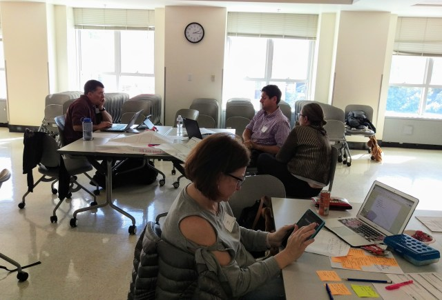 Educators working on their lesson documentation during a Remembering WWI workshop at UC Berkeley