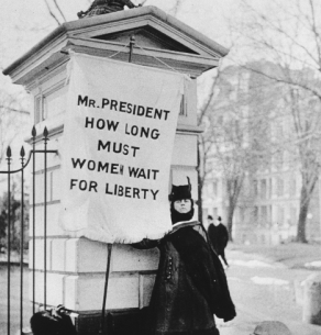 Woman picketing with a sign: Mr. President How Long Must Women Wait For Liberty