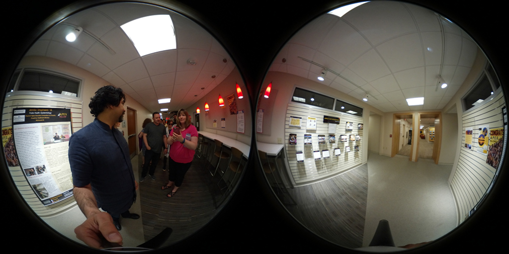 360 image of people walking down a hall